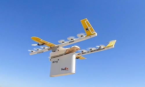A Wing delivery drone in the air.